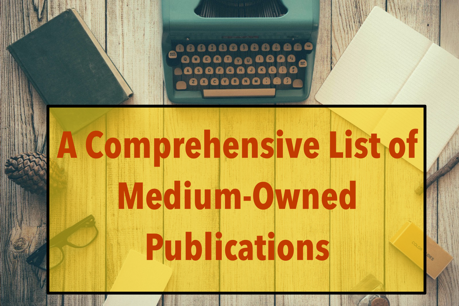 """A typewritter, several books and pens are arranged in a circle on a table. Text in the image reads, """"A comprehensive list of medium-owned publications."""""""